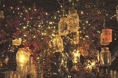Create a southern party look by hanging mason jar lights in the trees.