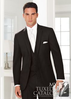 The Black 'Ceremonia' Suit is a classic, beautiful, well fitting suit. It features the updated, slimmer fit that most people are looking for today. While it is not a skinny suit, the updated cut is designed to have less excess fabric, and provide a more fitted shape to the wearer.  It is made of high quality tropical worsted wool, and has a matching three button vest, pre-tied bow tie, and flat front trousers.