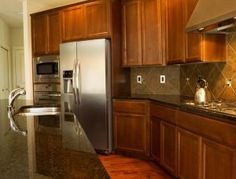 Is your kitchen in need of a face lift? There are so many wood stain colors available for your kitchen cabinets, so how do you choose? Read on for tips! Refacing Kitchen Cabinets, Kitchen Cabinet Colors, Kitchen Colors, Kitchen Appliances, Cabinet Refacing, Dark Cabinets, Staining Cabinets, Cleaning Cabinets, Wood Stain Colors