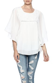 White chiffon blouse with short flutter sleeves and a rounded neckline.  White Angelic Blouse by Dex. Clothing - Tops - Blouses & Shirts Clothing - Tops - Short Sleeve Long Island