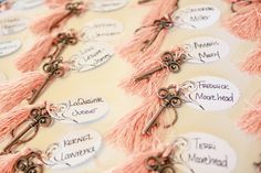 Attach each escort card to an antique key adorned with some fringe.
