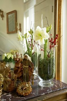 Festive Holiday Staircases and Entryways - Pretty paperwhites and red berry branches make a lovely entry display. – Traditional Home ® / P - Christmas Flowers, Noel Christmas, Christmas Crafts, Christmas Decorations, Xmas, Holiday Decor, Christmas Vignette, Christmas Arrangements, Floral Arrangements