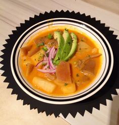 PAPAS CON CUERO....... Traditional Ecuadorean dish made with potatoes, pork skin, peanut sauce, served with avocado slices, red onion salsa and side of AJI (hot sauce).