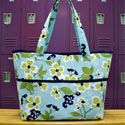 Tote tutorial w/ lots of details - zippered inner pocket, multiple open inner pockets & lining peeking out on top.