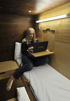 a fold down laptop desk over the bed, good for watching movies ect.