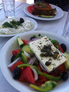 This is what a real Greek salad looks like in Grrece. - slab of feta. Delicious!!   Greek food (Salad, tzatziki & Moussaka)
