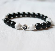 Yin Yang is a black and white symbol that represent the two aspect of the universe and life. Wear this necklace as a remind of balance. Handcrafted with love and intention in the U.S.A. Carefully stru