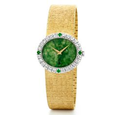Jackie Kennedy's iconic Piaget gold watch with a jade dial and white diamonds, as worn by Natalie Portman in the film Jackie. Discover the film 'Jackie', a biography about Jackie Kennedy, and her famous style which includes Piaget watches. The watch and jewellery brand lent Natalie Portman its watches and jewels for the filming of the biopic. http://www.thejewelleryeditor.com/jewellery/article/jackie-kennedy-film-piaget-dresses-natalie-portman-in-watch-jewellery/ #jewelry