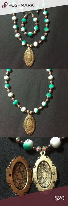 """Edwardian Style Locket Jewelry Set Cloisonne Beads """"The Travelling Lady's Locket""""  This is a beautiful handmade necklace, bracelet, and earring jewelry set made with large green and white glass beads, pink cloisonne beads, and spacers of hematite stones. The focal on the necklace is a beautiful light-weight working brass locket. The earrings are made for pierced ears however they can be changed for clip ons.  The length of each earring is 1.75"""". The necklace is 20.5"""" in length when open and…"""