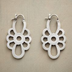 ROSETTE EARRINGS -- Jane Diaz hand cuts rosettes from sterling silver hung on snap down wires