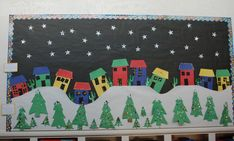 """The houses, pine trees, snowflakes, and snowy hillside in this """"Holiday Town"""" make for a cozy winter bulletin board display. I would give this display a title such as """"Winter Wonderland"""" Bulletin Board Tree, Christmas Bulletin Boards, Christmas Classroom Door, Winter Bulletin Boards, Classroom Bulletin Boards, Classroom Jobs, Creative Christmas Cards, Christmas Art, Christmas Projects"""
