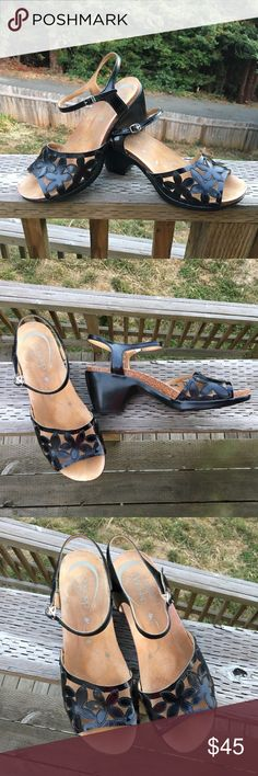 Dansko Black Leather Sandals, size 42 Re-poshed Dansko sandals....didn't work for me, but they are perfect for you! Very excellent used condition. Hardly any toe marks in the super soft footbed. Very cute cut-out flower design. No real scuffs on the shoe...pictures show the shoes accurately. Dansko Shoes Sandals