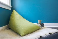 Turn an empty corner of your home into a cozy reading nook with this easy DIY bean bag chair. Using just a few items, you can complete it in one afternoon. Make A Bean Bag Chair, How To Make A Bean Bag, Big Bean Bag Chairs, Baby Bean Bag Chair, Bean Bag Lounge, Bean Bag Storage, Bean Bag Pattern, Big Bean Bags, Chaise Diy