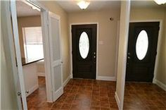 Entry offering a beveled glass front door,, tile flooring and mirror accents.