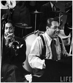 Composer pianist arranger Duke Ellington playing one of his compositions during an after hours jam session with some of the most exciting jazzmen in the city, at the studio of photographer Gjon Mili 1943 NYC