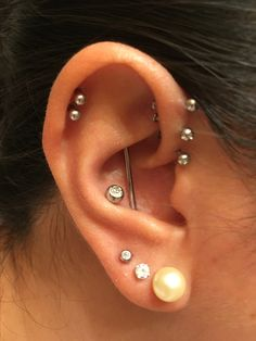 My Piercings. 3 lobes, conch, double cartilage, conch industrial, triple forward helix