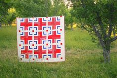 Diary of a Quilter - a quilt blog: Modern Red Cross Quilt inspired by a traditional Red Cross block created during World War 2.