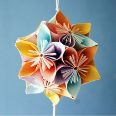 Paper Swan: Origami - instructions for several fun balls and stars Instruções Origami, Origami Artist, Origami Fish, Origami Design, Origami Flowers, Origami Ball, Paper Flower Ball, Paper Flowers, Art Flowers