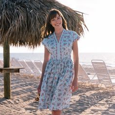 Cecily's v-neck design features a cinched waist and breathable fabric in an all-new sky blue floral for Sweater Scarf, Sweater Coats, Sweater Shop, Autumn Summer, Spring Summer Fashion, Daytime Dresses, Gal Meets Glam, Jumpsuit Dress, Poplin Fabric