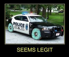 Seems Legit. Funny police car with donuts as tires. I must say, they look nice!. I would have preferred the chocolate covered, but to each their own.