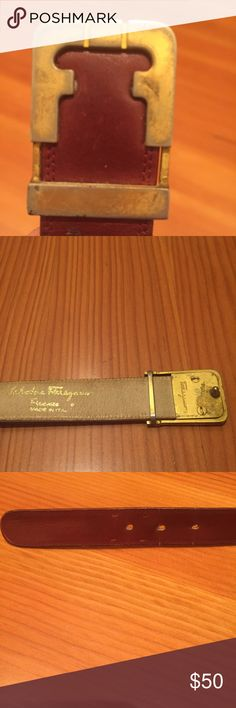 """Ferragamo Belt Vintage (70s or 80s) Ferragamo Italian Leather Belt -- narrow brown/red leather band -- gold tone buckle that had developed nice patina with age and scratches -- designed for actual waist or an extra small person if worn lower -- measurement when closed on middle loop is around 27"""" -- no serious flaws but definitely not new -- some wear around holes and on buckle and uneven softening of leather -- lots of life left in it! Salvatore Ferragamo Accessories Belts"""