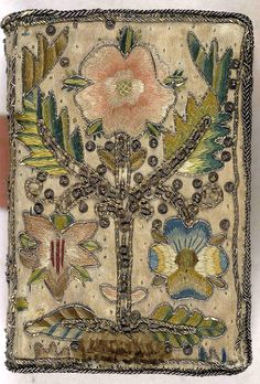 17th century embroidered satin book.