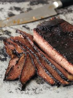 Smoked Brisket : Recipes : Cooking Channel 1 (4- to 6-pound) brisket, untrimmed, with a thick sheath of fat 5 tablespoons brown sugar 5 tablespoons kosher salt 1 tablespoon ground black pepper 4 1/2 teaspoons paprika 1 1/2 teaspoons dry mustard 1 tablespoon ancho chile powder 1/2 teaspoon granulated onion 1/4 teaspoon granulated garlic Brisket Sugar Shake (recipe follows) for serving