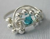 Wire Wrapped Ring Blue Crazy Lace Agate and Sterling Silver Fibonacci Sequence. $23.00, via Etsy.