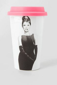 """This charming ceramic travel mug with a silicon lid features a picture of the delightful Audrey Hepburn as Holly Golightly reads, """"You can never go wrong with a little black dress.""""<br />  <br />  - Double walled to keep drinks hot<br />  - 8 oz; glass cup with silicon lid<br />  - Dishwasher and microwave safe<br />  - Imported<br />"""