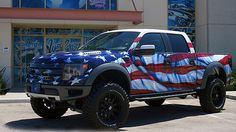 """Trucks don't get more American than this. The MobilityWorks Foundation is auctioning a high-performance 2014 Ford F-150 SVT Raptor truck to benefit its Cars for Troops charity which provides assistance to injured military veterans in need of specialized transportation. The truck has been outfitted with custom wheels, stars & stripes paint by West Coast Customs, American Flag interior. Nicknamed """"The Patriot,"""" the truck will cross the block at the Mecum Auctions in Dallas on September 6th…"""