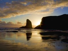 Sea Stacks and Reflections in Bandon, Oregon During Sunset.