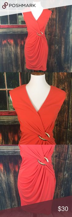 Cache Dress Beautiful orange dress with gold sinched accent around the waist. Size 2, small spot on the front (as seen in photo, hardly noticeable). Great condition otherwise. Cache Dresses Midi