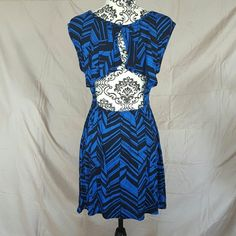 Open Back Chevron Dress Brand new without tags! Size Large. It is a very stretchy cotton blend. The back is open with a flutter top. Higher cut neckline in the front with cap sleeves. Anni Anna Dresses Mini