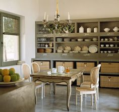 I'm drooling a little over the fabulous shelving system on the back wall of this dining room.