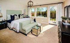 A private master suite at the back of the home showcases a private bath with separate shower and tub, plus a large walk-in closet. - Residence 1 at Carmel at Heritage Lake in Menifee, CA