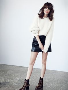 Alexa Chung in leather skirt, white sweater and leopard anckle boots