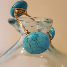 Beautiful wire bangle with turquoise stones Handmade gold wire bangle bracelet with 3 large turquoise stones. Great statement piece! Jewelry Bracelets