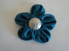 Kayla, Look cute fabric Daisy for your wreath. you could do them in white with yellow buttons.
