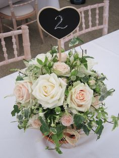 Flowerpot table display with chalkboard number
