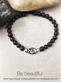I'm in love with this abalone with these beautiful beads. | Unique Beaded Stretch Bracelet - Yoga Bracelet, Boho Bracelet, Abalone Shell, Black Volcanic Lava Bead Bracelet, Black Bracelet | https://www.etsy.com/listing/263400159/unique-beaded-stretch-bracelet-yoga