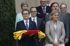Catalan Separatists Pull Off Human Chain But Referendum Is Harder - WSJ.com. #Catalonia's regional president #ArturMas, left, holds a regional flag surrounded by local politicians during ceremony to mark the #Diada de #Catalunya. Mr. Mas has recently made seemingly contradictory statements about the timetable for a proposed #independence #referendum.