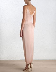 Sueded Silk Plunge Long Dress, from our Spring 16 collection, in Peony sueded silk. Draped detail through bodice and skirt. Fully boned bodice with wired plunge neckline and shoestring straps. Asymmetric draped skirt. Centre back zip closure, fully lined.