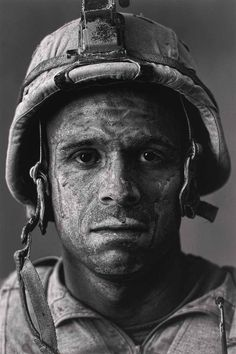 2008 - Gunnery Sergeant Carlos Orjuela. At 31, he was one of the oldest Marines in the unit at his base in Garmsir District, one of the most dangerous areas in Afghanistan. Read more: http://www.businessinsider.com/war-photography-images-of-armed-conflict-and-its-aftermath-photos-2013-10?op=1#ixzz33hO3o3X4