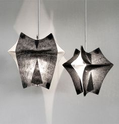 Se'Paar is a series of hanging lighting fixtures by Taeg Nishimoto, made of Buckram fabric....