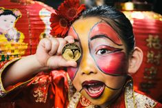 Lillian Sun, aged 6, from Meng's Dance School in Battersea, South London displays the Royal Mint's Lunar Year of the Sheep commemorative coin. The design has been specially minted for the Chinese New Year celebrations.