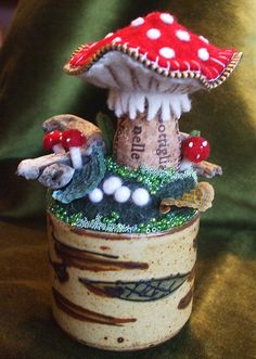 mushroom pincushion...love the cork base on the mushroom...inspirational