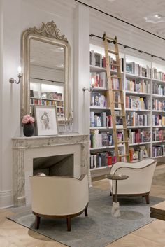 Club Monaco again. nice Chairs. Kind of reminds me of my living room with the white walls and bookcases