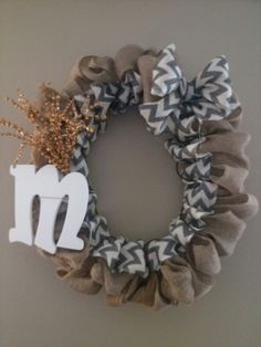 My burlap wreath made with a pool noodle i taped together.