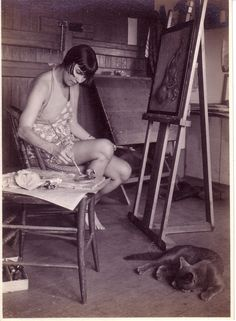 """ Wanda Gág painting in her studio with her cat. Photograph by Carl Zigrosser or Robert Janssen, Carl Zigrosser, her gallery manager (who was also one of her lovers) wrote: ""She is an enigmatic person, a taut equilibrium of of. Artist Art, Artist At Work, Artist Workspace, Mary Cassatt, Louise Bourgeois, Cat People, Famous Artists, American Artists, Art Studios"