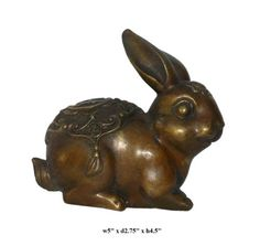 "This rabbit statue is made of bronze and has detailed carving. There is a Chinese character ""Wealth"" on the back   This is a nice table decor for good Feng Shui."